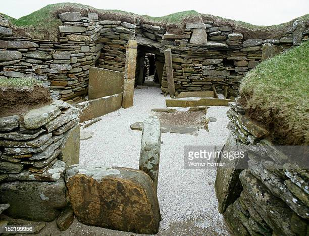 The interior of House 1 view of the hearth and the beds Houses like this were square or rectilinear oneroom houses with central hearth and flanking...