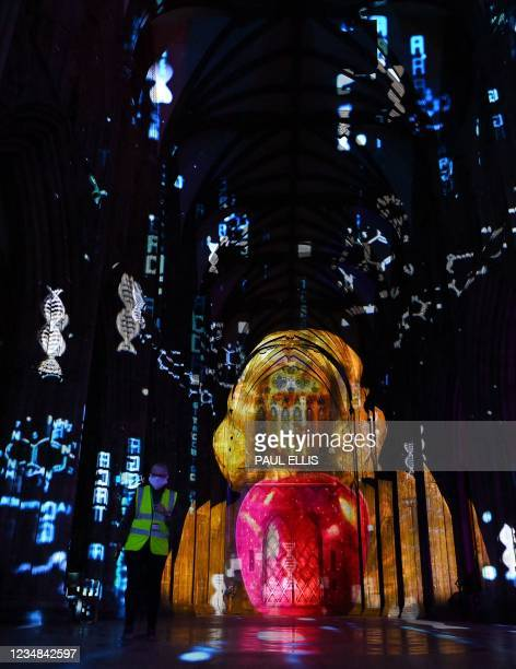 The interior of Lichfield Cathedral is bathed in colourful patterns of light during The Great Exhibition : Science light and sound projection show in...