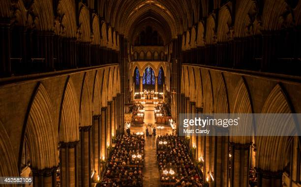 The interior of Salisbury Cathedral is illuminated by candle light during the annual 'darkness to light' advent procession on November 29 2013 in...