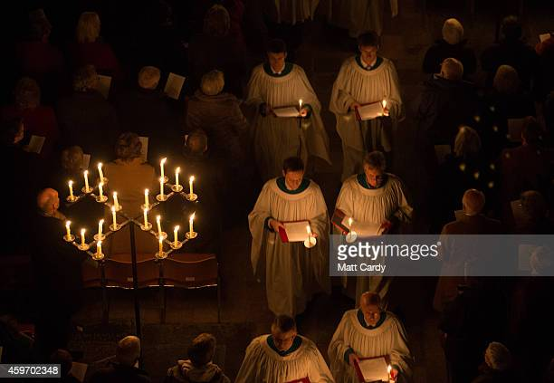 The interior of Salisbury Cathedral is illuminated by candles carried by choristers during the annual 'darkness to light' advent procession on...