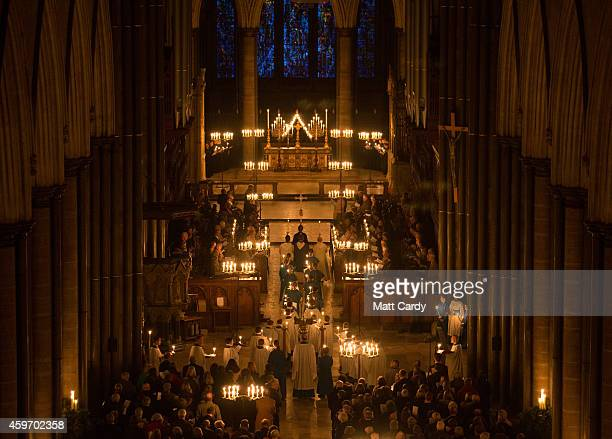 The interior of Salisbury Cathedral is illuminated by candles during the annual 'darkness to light' advent procession on November 28 2014 in...