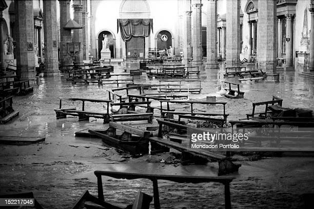 The interior of the basilica of Santa Croce in a mess because of the flood Florence 1966