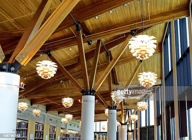 The interior of the beautiful wooden ceiling PH Artichoke light fixtures at the Oak Park Public Library in Oak Park Illinois