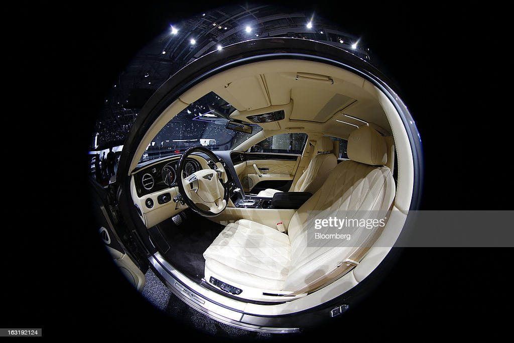 The interior of the Bentley Flying Spur automobile, produced by Bentley Motors Ltd., a luxury unit of Volkswagen AG (VW), is photographed with a fish-eye lens on the first day of the 83rd Geneva International Motor Show in Geneva, Switzerland, on Tuesday, March 5, 2013. This year's show opens to the public on Mar. 7, and is set to feature more than 100 product premiers from the world's automobile manufacturers. Photographer: Valentin Flauraud/Bloomberg via Getty Images
