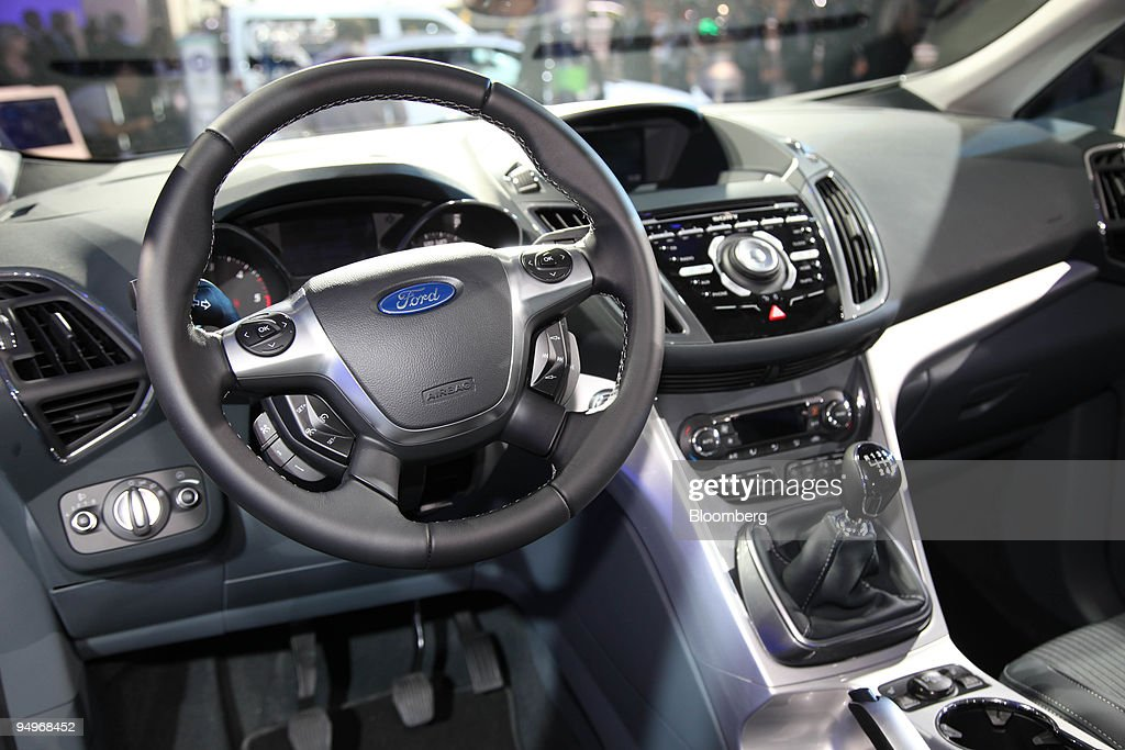 The interior of the Ford Grand C-Max automobile is seen on t ...