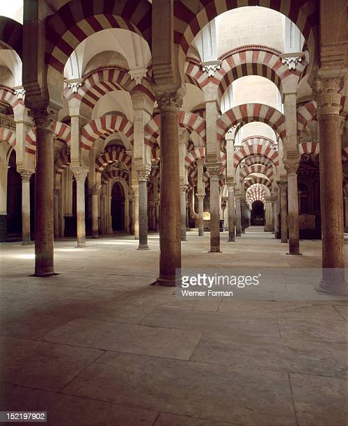 The interior of the Great Mosque at Cordoba The original 8th century mosque had ten arcades only Spain Islamic Begun 786 AD