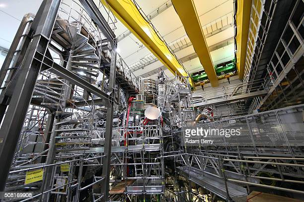 The interior of the new Wendelstein 7-X nuclear fusion experimental device is seen during an initial hydrogen plasma test at the Max-Planck-Institut...