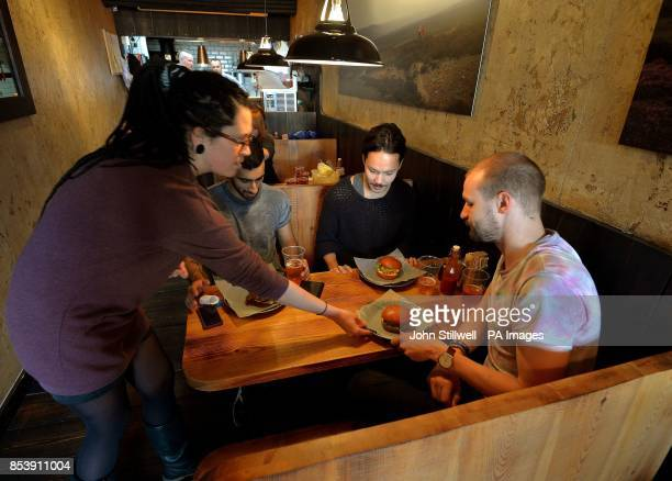 The interior of the popular Bukowski Burger bar in Boxpark Shoreditch east London which serves a Fat Gringo burger the beef patty is cooked in a...