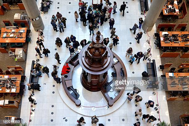 The interior of the Richard Rogers designed Lloyds of London. In the centre of the iconic trading floor is the Lutine Bell. Lloyd's of London is the...