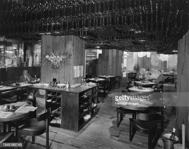 The interior of The Taverne at the Swiss Centre. The Swiss Centre was designed by David Aberdeen and was built by John Laing & Son Ltd. It had shops...