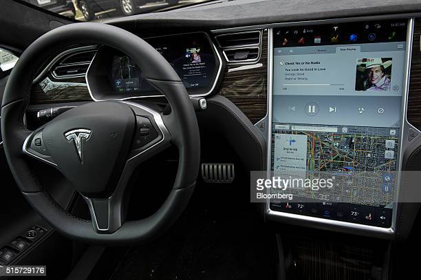 The interior view of a Tesla Motors Inc Model S P90D a model with some autopilot features is seen during an exhibition featuring several selfdriving...