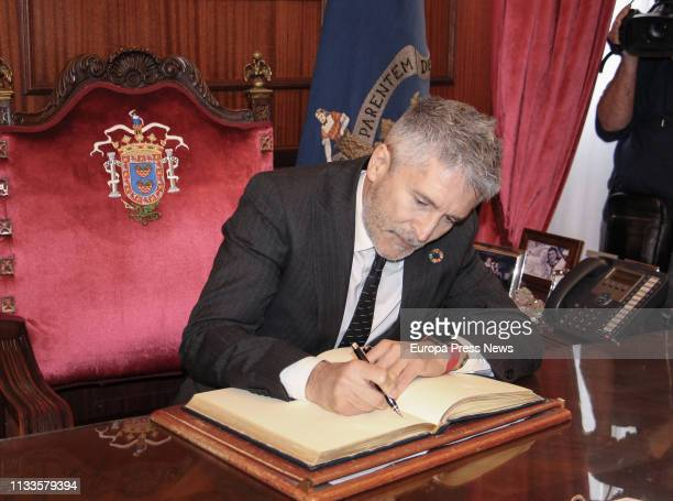 The Internal Affairs minister Fernando GrandeMarlaska signs in the book of the Melilla town hall during a visit along of the border with Marruecos on...