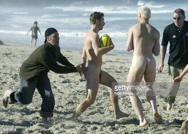 The International Barbarians Nick Treadwell is tackled by Nigel Hobbs of the Kiwi Selection during the International Nude Touch Rugby match at St...