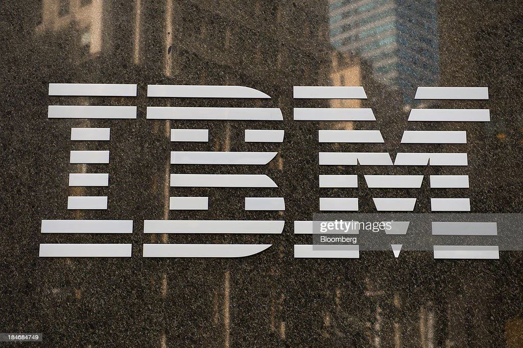 The International Business Machines Corp. (IBM) logo is displayed in front of the company's offices in New York, U.S., on Monday, Oct. 14, 2013. International Business Machines is scheduled to report 3Q results post-market tomorrow. Photographer: Craig Warga/Bloomberg via Getty Images