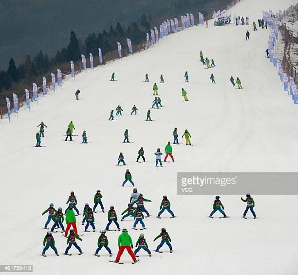 The international children's skiing festival is held at Yuyang International Ski Resort in Beijing's Pinggu District during the World Snow day to bid...