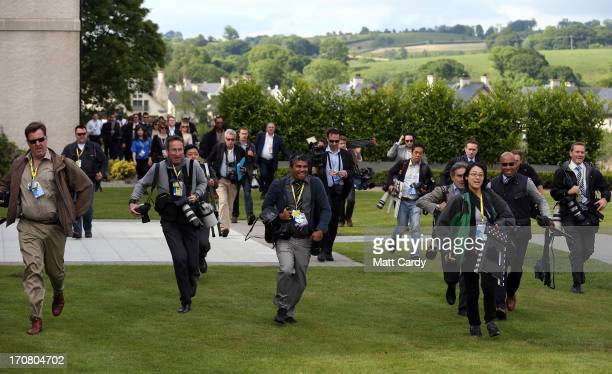 The international media arrive for the 'family' group photograph at the G8 venue of Lough Erne on June 18 2013 in Enniskillen Northern Ireland The...
