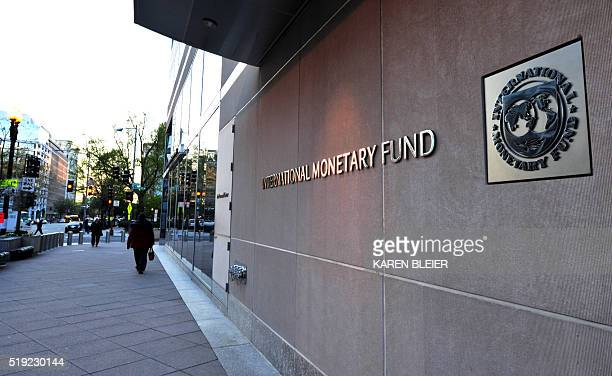 The International Monetary Fund building sign is viewed on April 5, 2016 in Washington, DC. This years Spring Meetings events will take place in...