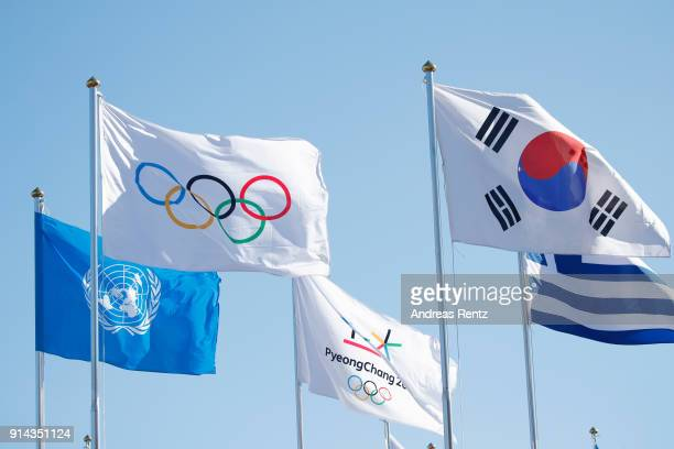 The International Olympic Committee flag beside the National flag of Korea is pictured at the inauguration of the Olympic truce mural during previews...