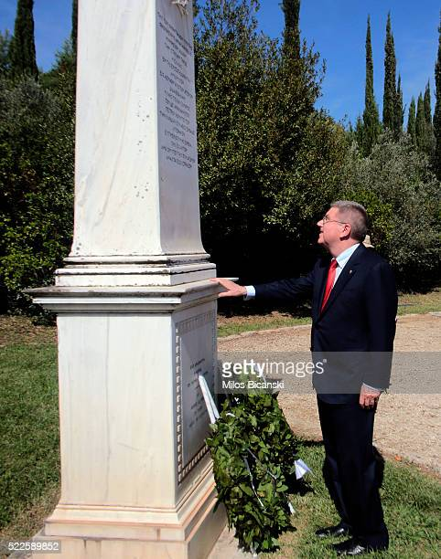 The International Olympic Committee President Thomas Bach visits the grave of the father of the modern Olympic Games Pierre de Coubertin during the...