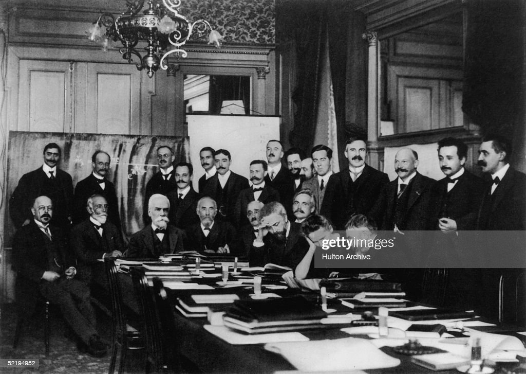The international physics conference convened in Brussels by Belgian chemical magnate Ernest Solvay, 1911. Perhaps the most formidable gathering of scientists ever, most are Nobel laureates. Left to right standing: Victor Goldschmidt, Max Planck, Rubens, Somerfeld, Lindemann, Louis Victor De Broglie, Knudsen, Hasenohrl, Hostelet, Herzen, James Hopwood Jeans, Ernest Rutherford, Heike Kamerlingh-Onnes, Albert Einstein, Paul Langevin. Left to right seated at table: Walther Nernst, Marcel Louis Brillouin, Ernest Solvay, Hendrik Lorentz, Otto Heinrich Warburg, Jean Baptiste Perrin, Wilhelm Wien, Madame Marie Curie, Jules Henri Poincare.