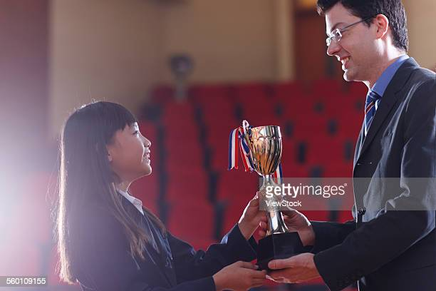 The international primary school teacher was giving pupils Awards