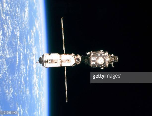 The International Space Station 03 June 1999 as seen from the US space shuttle Discovery as the shuttle does a fly around after undocking with the...
