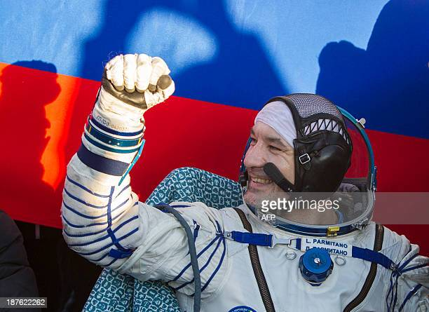 The International Space Station crew mamber of Italian astronaut Luca Parmitano gestures after landing in a remote area near the town of Zhezkazgan...