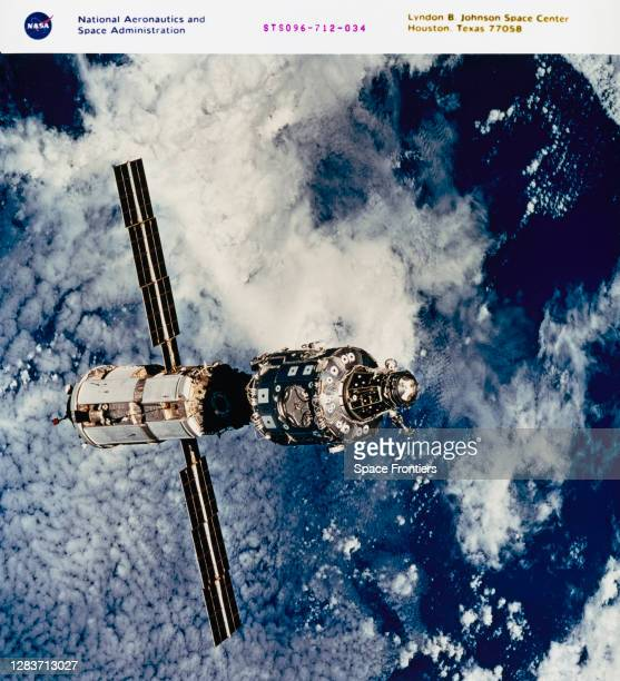 The International Space Station in an image taken by crewmembers onboard the Space Shuttle Discovery during a fly-around following separation of the...