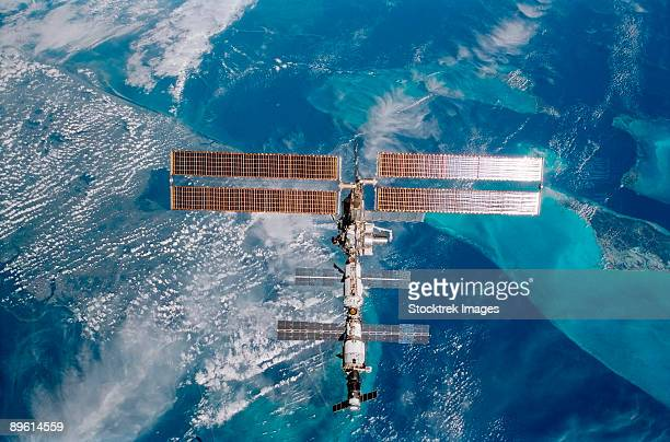 the international space station is backdropped over miami, florida.  - international space station stock pictures, royalty-free photos & images