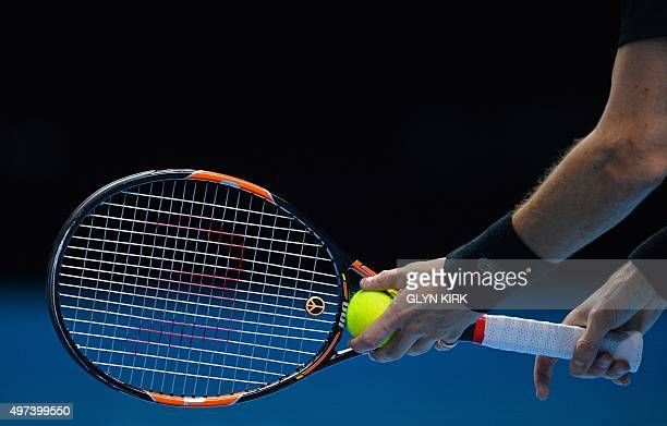The international symbol for peace is seen on the raquet of France's Nicolas Mahut during his men's doubles group stage match against Croatia's Ivan...