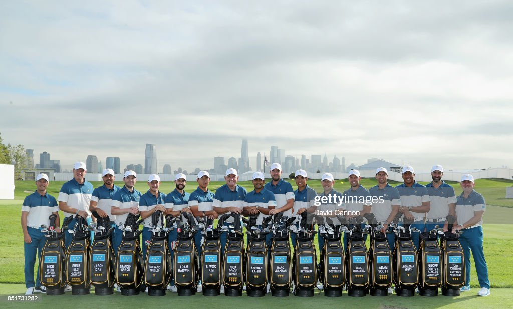 The International Team (L-R) Mike Weir (assistant captain), Ernie Els (assistant captain), Jason Day, Branden Grace, Emiliano Grillo, Adam Hadwin, Si Woo Kim, Nick Price (captain), Anirban Lahiri, Marc Leishman, Hideki Matsuyama, Louis Oosthuizen, Charl Schwartzel, Adam Scott, Jhonattan Vegas, Geoff Ogilvy, Tony Johnstone pose for the official team photograph before practice for the 2017 Presidents Cup at the Liberty Natioanl Golf Club on September 27, 2017 in Jersey City, New Jersey.
