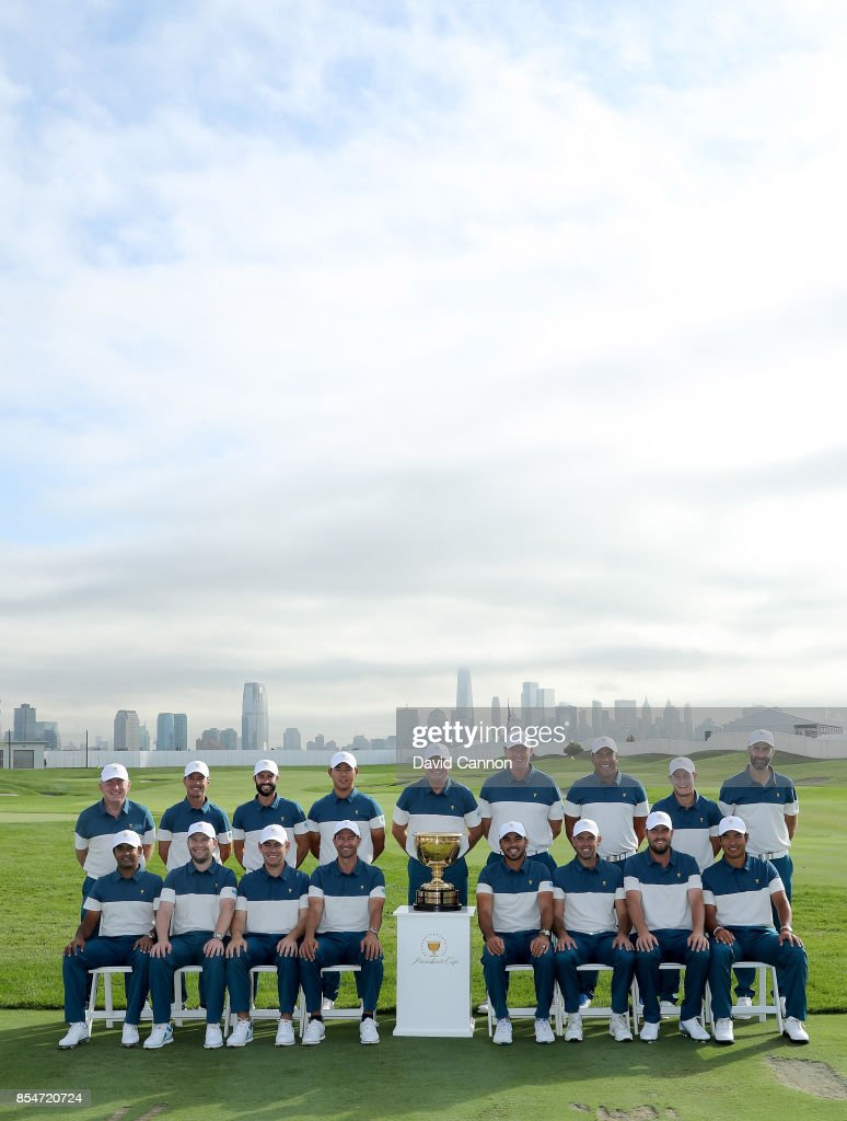 The International Team (L-R standing) Tony Johnstone (assistant captain), Mike Weir (assistant captain), Adam Hadwin, Si Woo Kim, Nick Price (captain), Ernie Els (assistant captain), Jhonattan Vegas, Emiliano Grillo, Jeff Ogilvy (assistant captain), (L-R sitting) Anirban Lahiri, Branden Grace, Louis Oosthuizen, Adam Scott, Jason Day, Charl Schwartzel, Marc Leishman, Hideki Matsuyama pose for the official team photograph before practice for the 2017 Presidents Cup at the Liberty Natioanl Golf Club on September 27, 2017 in Jersey City, New Jersey.