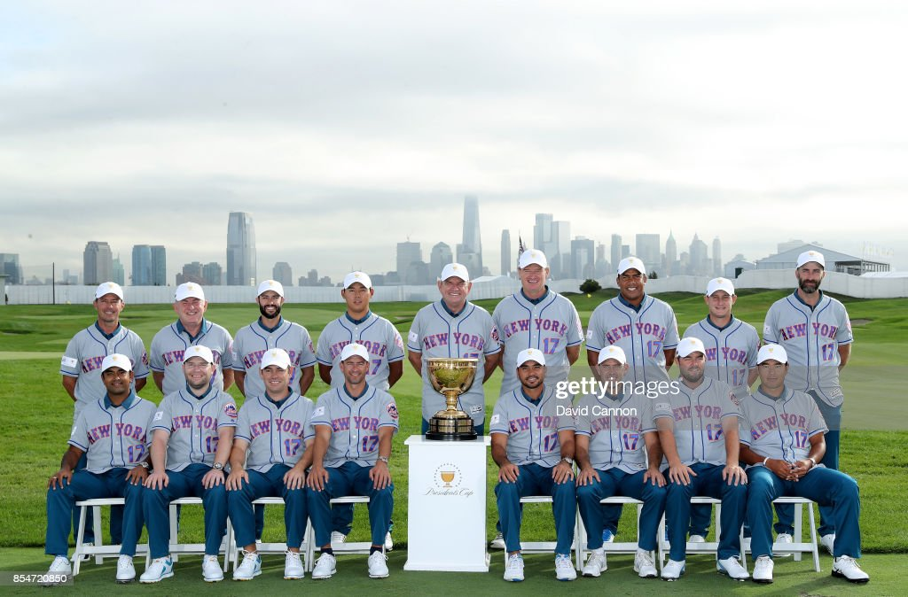 The International Team wear New York Mets Baseball jerseys as they pose for the official team photographs (L-R standing) Tony Johnstone (assistant captain), Mike Weir (assistant captain), Adam Hadwin, Si Woo Kim, Nick Price (captain), Ernie Els (assistant captain), Jhonattan Vegas, Emiliano Grillo, Jeff Ogilvy (assistant captain), (L-R sitting) Anirban Lahiri, Branden Grace, Louis Oosthuizen, Adam Scott, Jason Day, Charl Schwartzel, Marc Leishman, Hideki Matsuyama before practice for the 2017 Presidents Cup at the Liberty Natioanl Golf Club on September 27, 2017 in Jersey City, New Jersey.