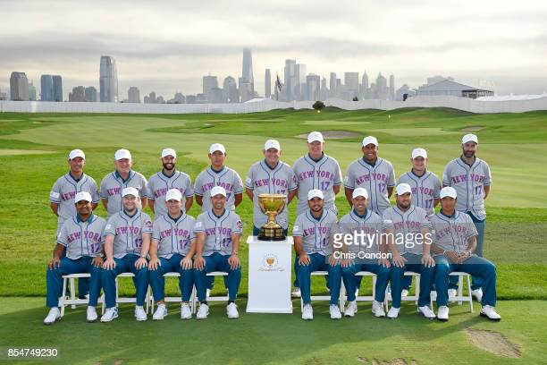 The International Team wears New York Mets jerseys as they poses for a group photo with the Presidents Cup trophy prior to the start of the...