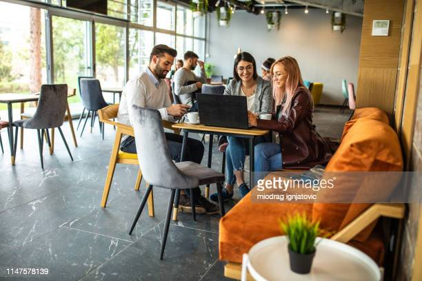 the internet takes care of their business needs - internet cafe stock pictures, royalty-free photos & images