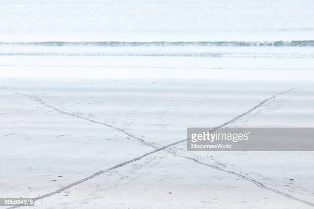 the intersected trace on the beach in the morning