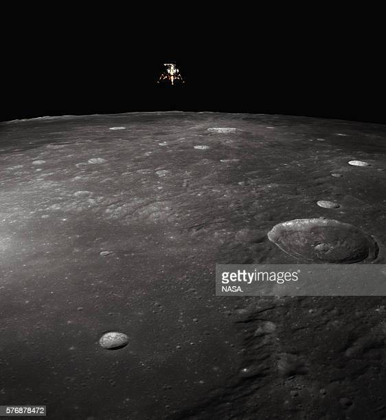 The Intrepid Apollo 12's lunar module lands on the surface of the moon