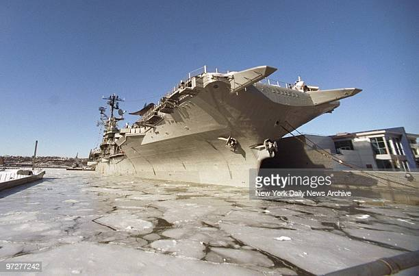 The Intrepid SeaAirSpace Museum sits serenely amid the Hudson River ice at W 46th St pier