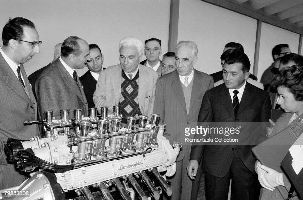 The introduction of the new Lamborghini 350GTV at the Lamborghini Factory Sant'Agata October 1963 A group of pleased visitors stand next to a display...