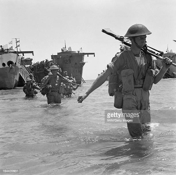 The Invasion Of Sicily July 1943 Troops wade ashore from landing ships 10 July 1943
