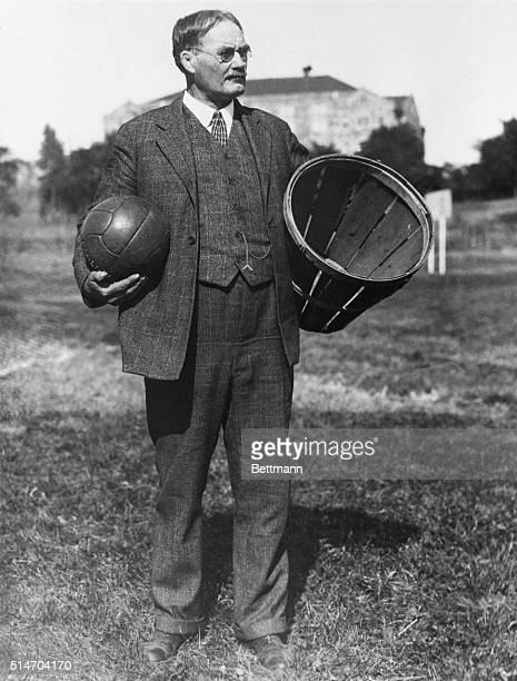 The inventor of basketball, Dr. James Naismith, stands in a field carrying a ball and a basket.