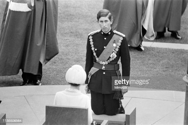 The Investiture of Prince Charles at Caernarfon Castle, Caernarfon, Wales, Prince Charles kneels before the HRH Queen Elizabeth II, 1st July 1969.