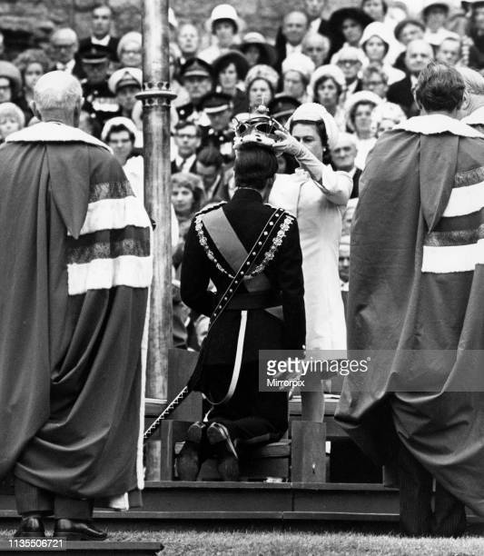 The Investiture of Prince Charles at Caernarfon Castle, HRH Queen Elizabeth II places the crown on the head of Prince Charles, Caernarfon, Wales, 1st...