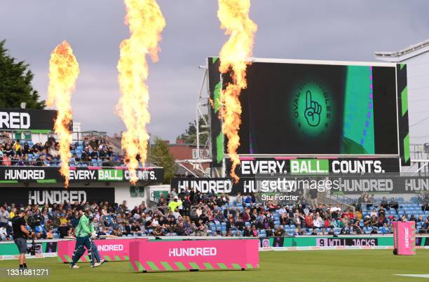 The Invincibles batting team come out to flames during The Hundred match between Northern Superchargers Men and Oval Invincibles Men at Emerald...