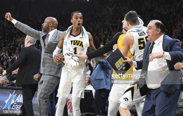 The Iowa bench reacts after a gamewining shot by Iowa Hawkeyes guard Jordan Bohannon during a Big Ten Conference basketball game between the...