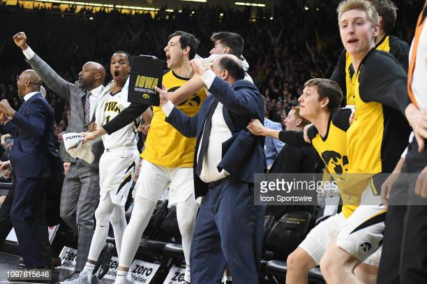 The Iowa bench reacts after a gamewinning shot by Iowa Hawkeyes guard Jordan Bohannon during a Big Ten Conference basketball game between the...