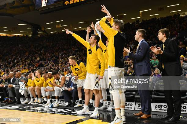 The Iowa bench reacts to a threepoint shot by Iowa guard Jordan Bohannon in the first half during a Big Ten Conference basketball game between the...