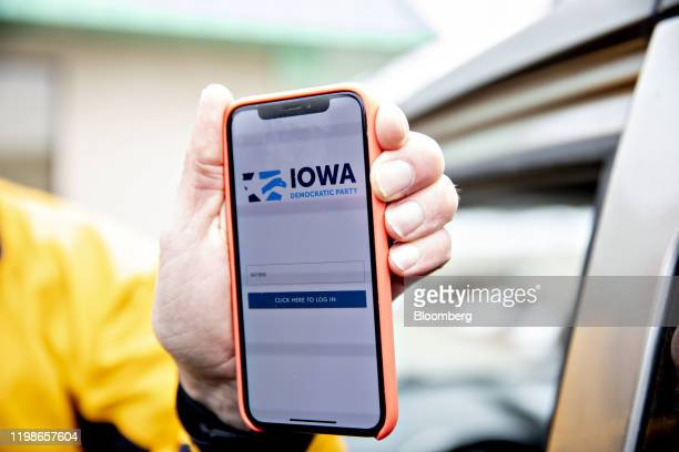 The Iowa Democratic Party caucus app is displayed on an iPhone outside Iowa Democratic Party headquarters in Des Moines Iowa US on Tuesday Feb 4 2020...