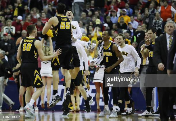 The Iowa Hawkeyes celebrate after defeating the Cincinnati Bearcats 7972 in the first round of the 2019 NCAA Men's Basketball Tournament at...