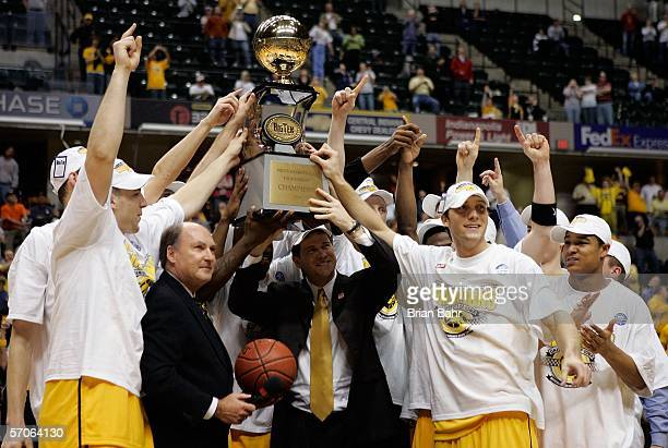 The Iowa Hawkeyes celebrate and hold up the trophy as the Hawkeyes win the Big 10 Tournament Championship game 6760 against the Ohio State Buckeyes...